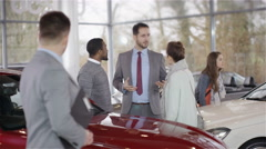 4K Portrait of smiling salesman working in car dealership - stock footage