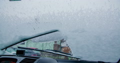 Windscreen wipers are cleaning all the snow on the front window Stock Footage