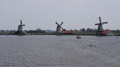 Zaanse Schans Netherlands windmills and rowers on the lake Stock Footage
