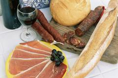 Cold meats with bread and wine - stock photo
