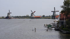 Zaanse Schans Netherlands windmills seen from behind the dock house Stock Footage