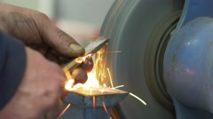 Stock Video Footage of Sharpens Chisel On The Machine