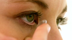 Woman about to insert her contact lens Stock Footage