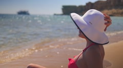 Girl sitting on the egyptian beach Stock Footage