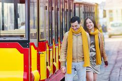 Stock Photo of happy loving couple posing near a tram in the city Lviv