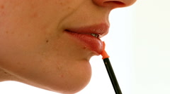 Woman putting on lip gloss - stock footage