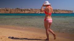Girl walk along the beach Stock Footage