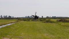 Zaanse Schans Netherlands small windmill. Iconic landmark in the north Stock Footage