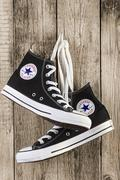 Black Converse shoes on wooden - stock photo