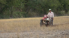 Rural Vietnam, global warming, failed harvest, dry rice paddy field, plowing Stock Footage