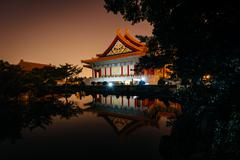 The National Concert Hall and a pond at night, at Taiwan Democracy Memorial P Stock Photos