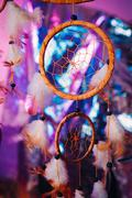 Dream catcher on the bright multicolored background Stock Photos
