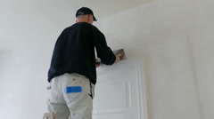 Room renovation. Plasterer at work - stock footage