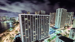 Time Lapse - Nightime View of Downtown Honolulu, Hawaii with Clouds - stock footage