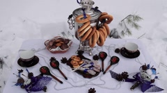 Decorated table standing in the snow. Arkistovideo