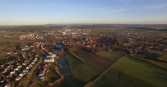 4K Aerial, Flight over landscape around small village in germany Stock Footage