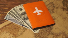 Passports and money over map background Stock Footage