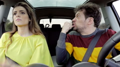 Stock Video Footage of Man and woman wanting to punch each other angry in car slow motion