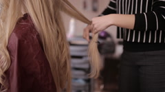 Stock Video Footage of professional hairdresser makes hair styling for blondes