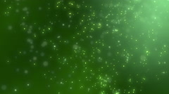 Abstract sharp and blurred  particles swarming against green background Stock Footage