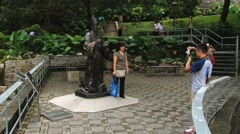 People make travel photo with the statue of Matteo Ricci in Macau, China. Stock Footage