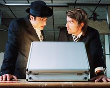 Gangsters with briefcase - stock photo