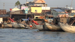 Traditional wooden cargo vessels in the Mekong Delta, transportation in Vietnam Stock Footage