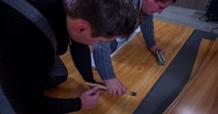 Two guys are making wood flooring Stock Footage