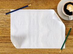 Blank paper on wood table with pencils and coffee cup Stock Illustration