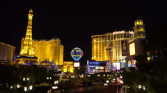 Las Vegas strip at night. Eiffel tower and Planet Hollywood - stock footage