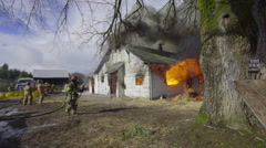 Wide shot of house on fire - stock footage