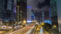Hong Kong Business District timelapse at Night. Corporate building at the back Stock Footage