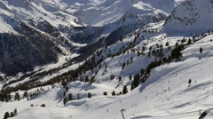 Alps mountains view with skiers Stock Footage