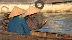 Rural Vietnam, modern technology, mobile phone, contrast, women, traditional Stock Footage