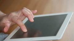 A hand touching tablet computer surface touchscreen Stock Footage