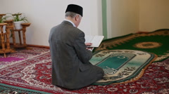 An old mullah reading the Koran Stock Footage