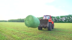 Farmers field full of hay bales. Harvesting. Hay in the coils Stock Footage