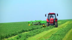 Tractor mowing grass . animal Feed Stock Footage