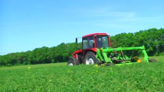 Mowing grass . Tractor trailer . Mower. Farm Stock Footage