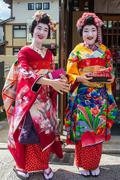 KYOTO, JAPAN - OCTOBER 14, 2015 : portrait of two smiling Maiko, Apprentices - stock photo