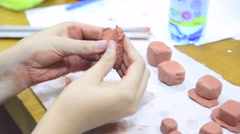 Hands sculpting with clay Stock Footage