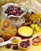 Medicinal herbs with honey. - stock photo