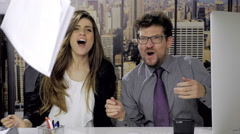 Happy succesful business people throwing documents in the air in office looki Stock Footage