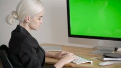 Young Woman Using Computer With Green Screen Display Stock Footage