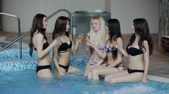 Five beautiful girls in bikini drinking champagne at the pool Stock Footage