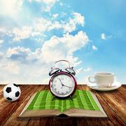Time to rest with coffee and soccer book - stock photo