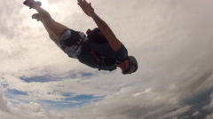 Skydiving performance cloudy day - stock footage