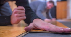 Carefully placing a wood panel on the floor Stock Footage
