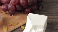 Stock Video Footage of Healthy lifestyle plate of meat with grapes on wooden background