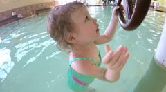 Toddler playing in indoor pool at a recreational center. Stock Footage